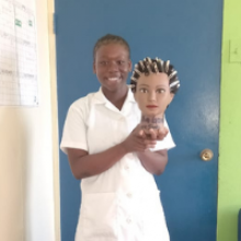 18 year old lady in a white outfit, holding a mannequin head for cosmetology