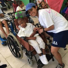Volunteer and resident in wheelchair